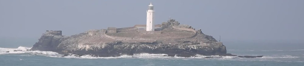 http://ak.picdn.net/shutterstock/videos/5873252/preview/stock-footage-godrevy-lighthouse-cornwall-coast-england-uk.jpg